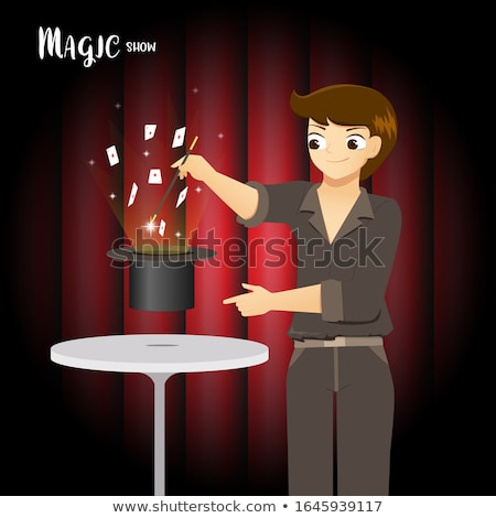 Magician making trick with wand and playing cards Stock photo © ra2studio