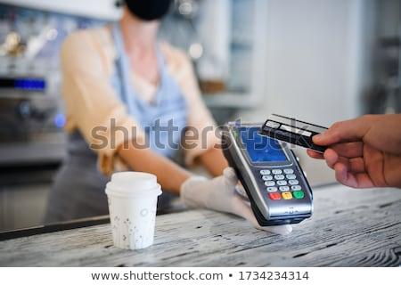 оплата кафе современных блондинка женщины запястье Сток-фото © pressmaster