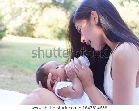 Nő baba zöld park anya etetés Stock fotó © robuart
