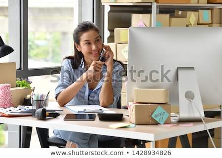 Startup small business SME, entrepreneur owner  using smartphone Stock photo © snowing