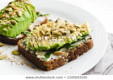 Veganistisch avocado gezonde peterselie plaat top Stockfoto © YuliyaGontar