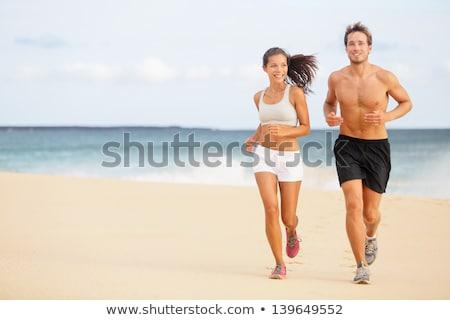 を実行して · ジョギング · 海浜砂 · 幸せ · 小さな - ストックフォト © andreypopov