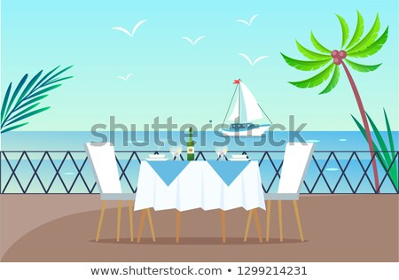 restaurant on wooden pier served table and seaside stock photo © robuart