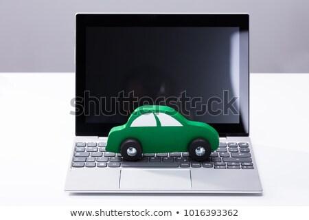 green car on laptop keypad stock photo © andreypopov