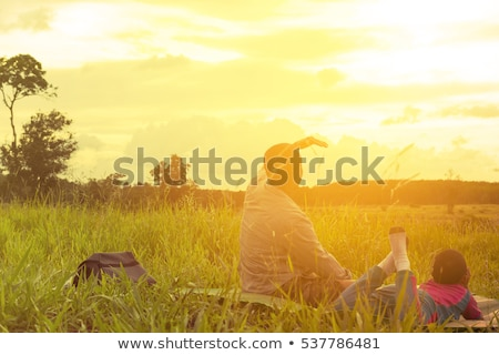 beautiful father little toddler son on the meadow stock photo © lopolo