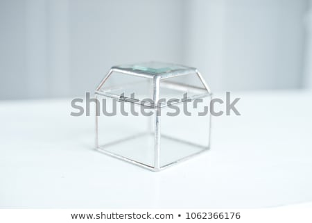 wedding rings in a glass box on the table for ceremonies stock photo © ruslanshramko