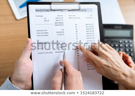 Overview of human hands over financial paper during discussion of expenses Stock photo © pressmaster