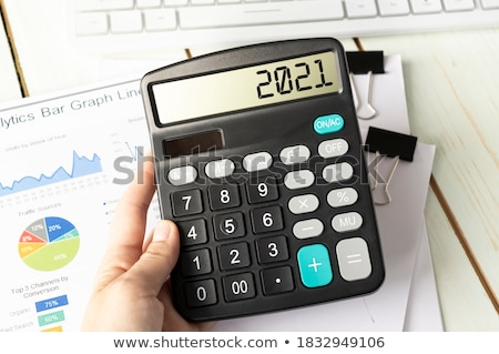 A calculator with the word Revenues on the display Stock photo © Zerbor