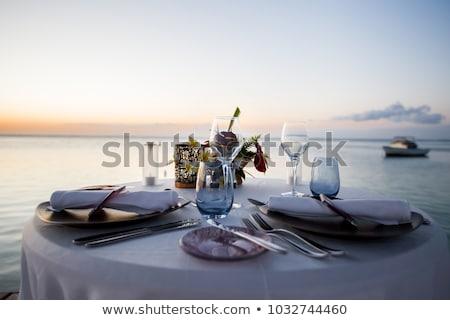 Romantique dîner plage coucher du soleil mariage tropiques Photo stock © galitskaya