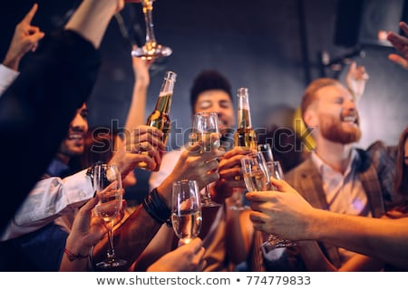 happy young casual couple with flutes of champagne toasting with mixed race girl stock photo © pressmaster