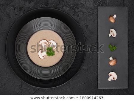 Fekete étterem tányér krémes gesztenye champignon Stock fotó © DenisMArt