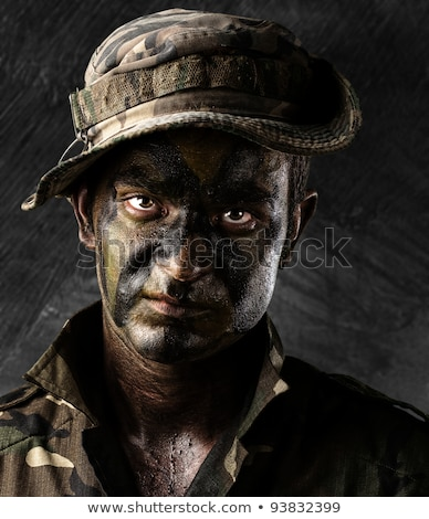 Armed soldier with damaged wall background Stock photo © ra2studio
