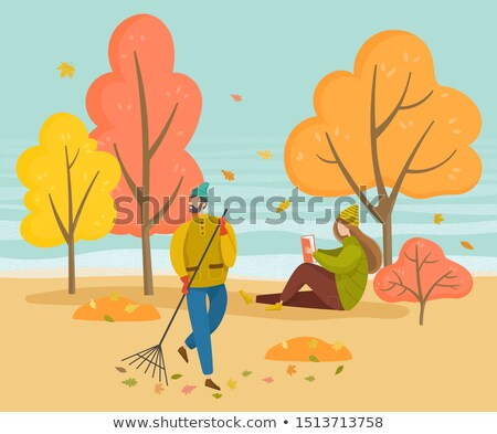 Man Sweep Foliage, Girl Read Book in Autumn Park Stock photo © robuart