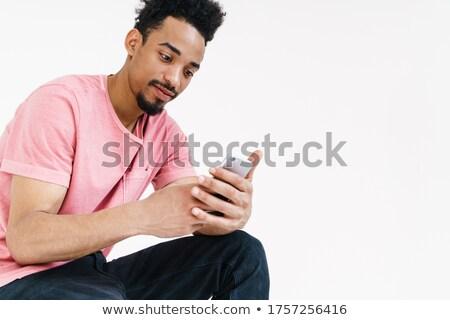 Obraz zagęszczony człowiek posiedzenia ściany Zdjęcia stock © deandrobot