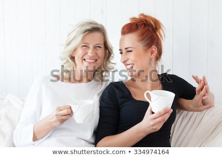 Anya lánygyermek megnyugtató együtt kanapé mezítláb Stock fotó © Giulio_Fornasar