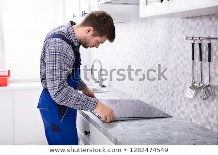 Elektromos tűzhely javítás karbantartás nő konyha Stock fotó © AndreyPopov
