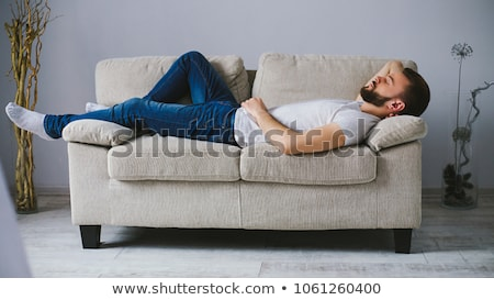 бизнесмен · диване · ноутбука · белый · человека · клавиатура - Сток-фото © RuslanOmega