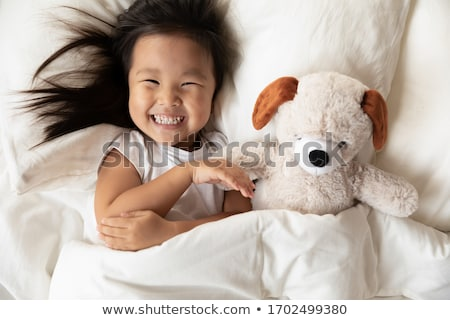 child girl relaxed on pillow looking camera Stock photo © lunamarina