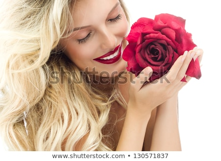 Blonde woman with rose in hand Stock photo © photography33