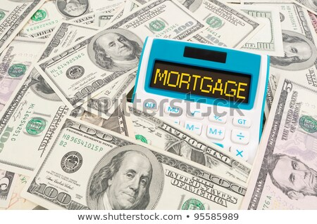 Mortgage word on calulator with American notes Stock photo © Ansonstock