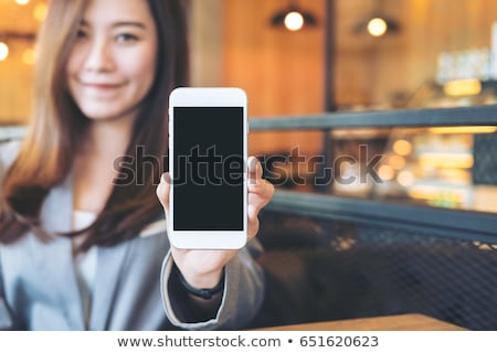businesswoman holding cell-phone Stock photo © photography33