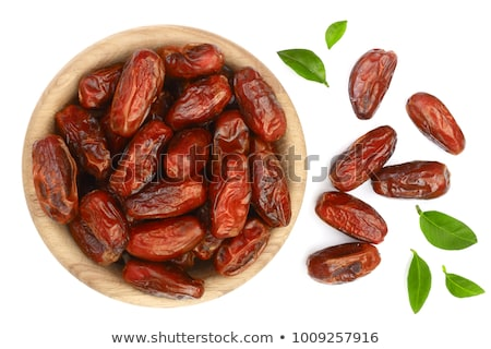 dried dates on wooden background stock photo © anskuw