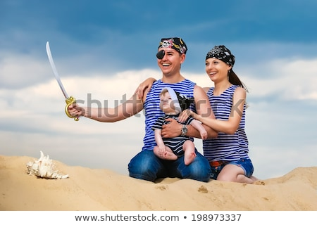 Pirate girl with sabre on blue background Stock photo © pzaxe