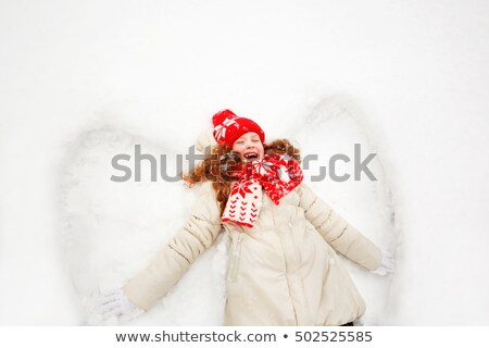Little girl laying in the snow Stock photo © photography33