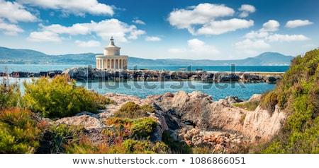 Világítótorony kék tenger víz épület kő Stock fotó © ElinaManninen