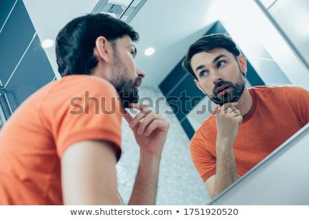 Adulte réfléchissant homme toucher menton portrait Photo stock © pablocalvog