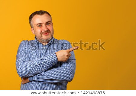 Close up of serious businessman with his arms folded against a white background Stock photo © wavebreak_media