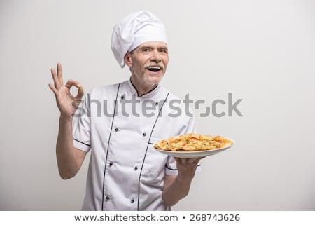 Mature chef holding pizza stock photo © wavebreak_media