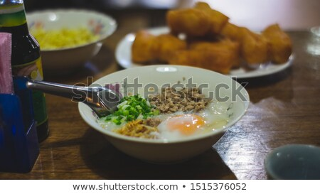 Mini meal of hot pork soup and boiled egg  Stock photo © nalinratphi