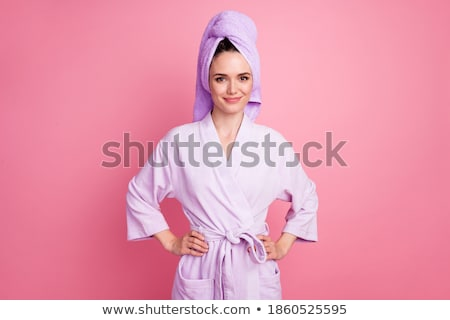 Young Woman Wearing Bath Towel with Hands on Hips stock photo © dash