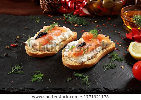 canape with caviar, salmon and cheese Stock photo © M-studio