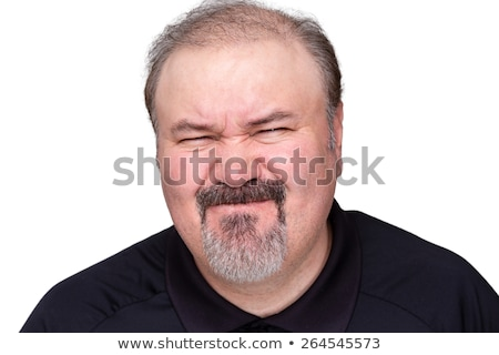 Disgusted man pulling a disdainful expression Stock photo © ozgur