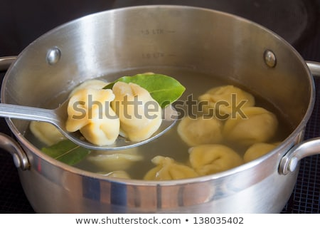 russian pelmeni boiling in pot Stock photo © Mikko