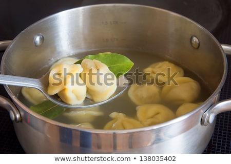 russian pelmeni boiling in pot Stock photo © Mikko