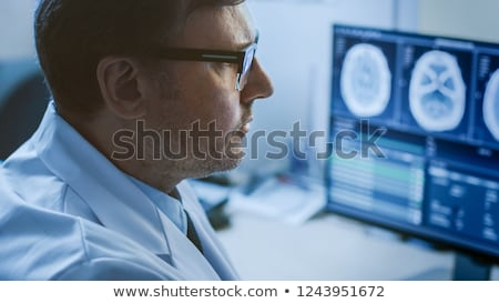 doctor looking at brain mri stock photo © hasloo