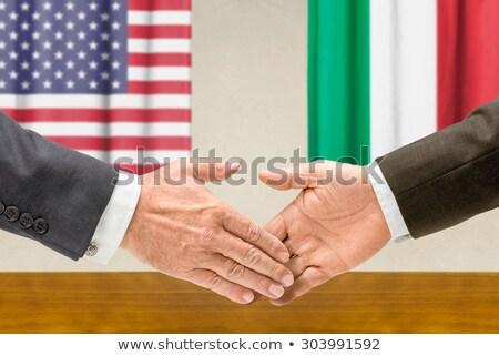 Representatives of the USA and Italy shake hands Stock photo © Zerbor