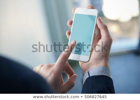 Empresário tela sensível ao toque trabalhando mesa de escritório móvel Foto stock © stokkete