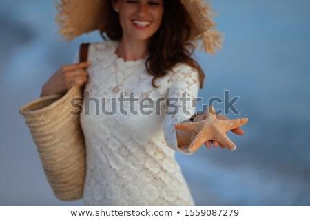 beautiful woman with seashell and starfish on seacoast, closed e Stock photo © Paha_L