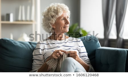 senior lady sitting knitting at home stock photo © ozgur