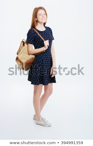 full length portrait of a pretty redhead woman in dress stock photo © deandrobot