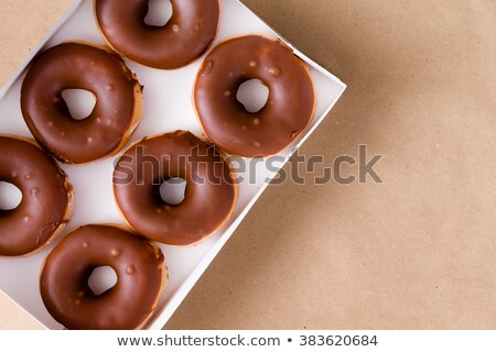 Top down view of chocolate and cream donuts in box Stock photo © ozgur