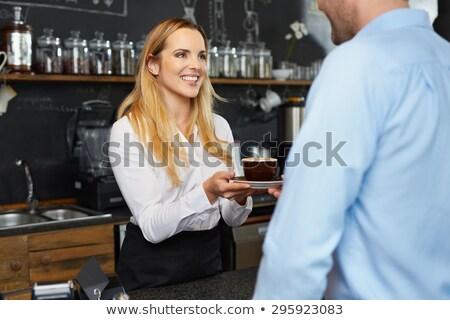 улыбаясь Бариста предлагающий кофе довольно клиентов Сток-фото © wavebreak_media