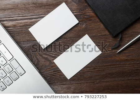 blank business card mockup with a keyboard on white background stock photo © akhilesh