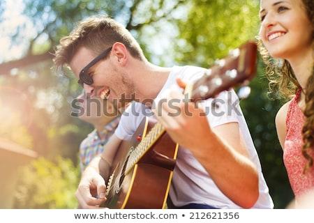 Uomo chitarra esterna musica moda Foto d'archivio © deandrobot