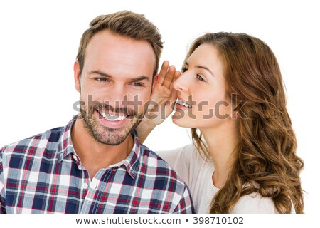 beautiful couple sharing a secret stock photo © fouroaks