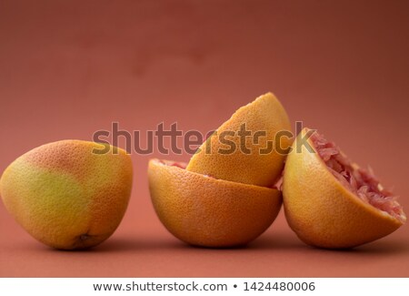 Arrangement of freshly squeezed grapefruit halves Stock photo © ozgur